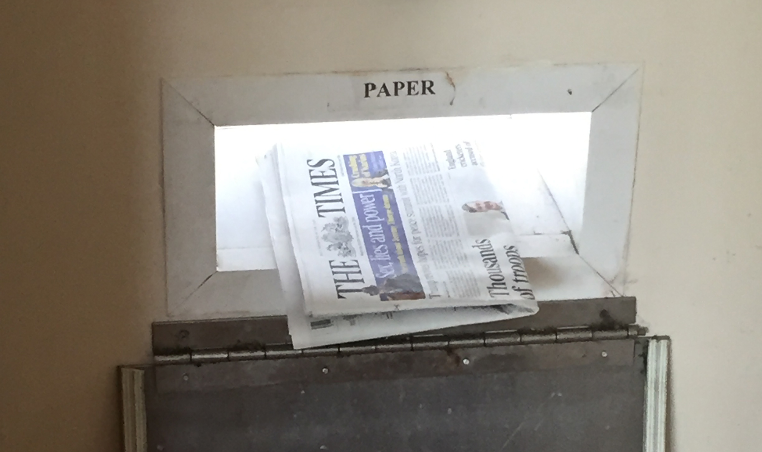 Hole in wall for paper recycling