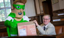 Councillor David Lancaster and the Recycle for Greater Manchester recycling superhero