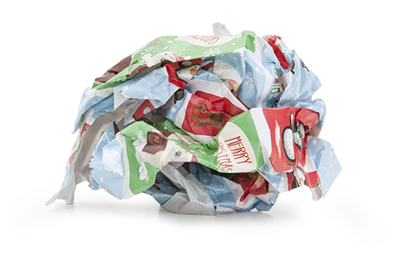 A scrunched up ball of Christmas wrapping paper