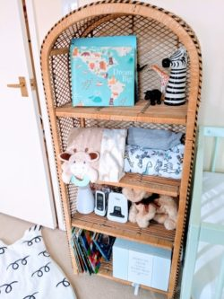 Secondhand wicker shelf with books and toys