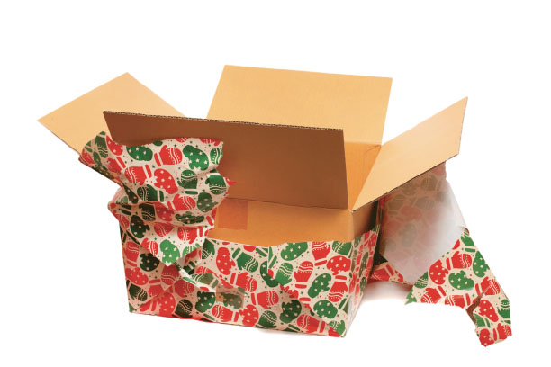Cardboard box with torn wrapping paper