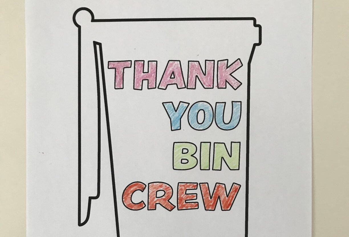 wheelie bin with coloured letters in side saying Thank you bin crew