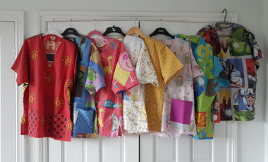 Scrubs made out of duvet covers hanging on a wardrobe door