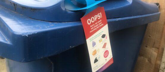 Blue bin with tag
