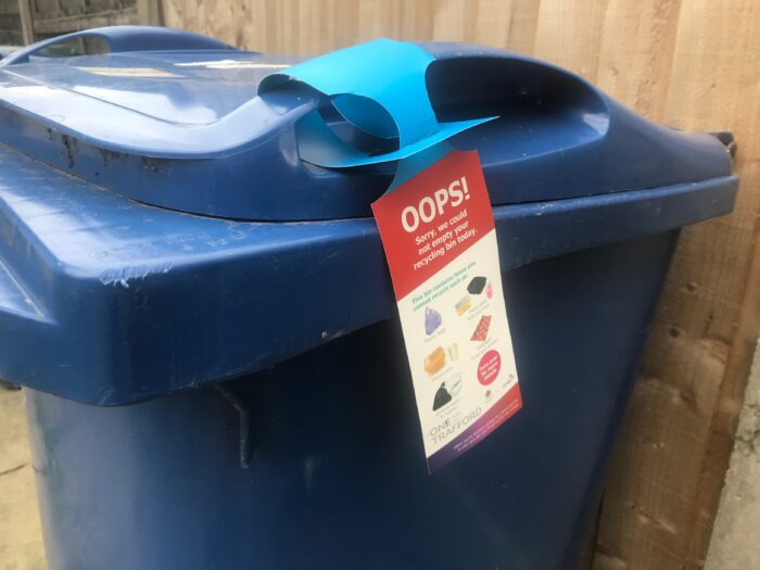 Blue bin with tag