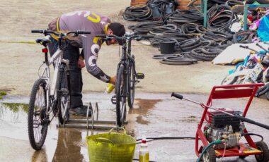 Man cleaning bike wheels