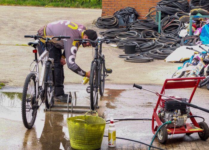 Man checking bike wheels