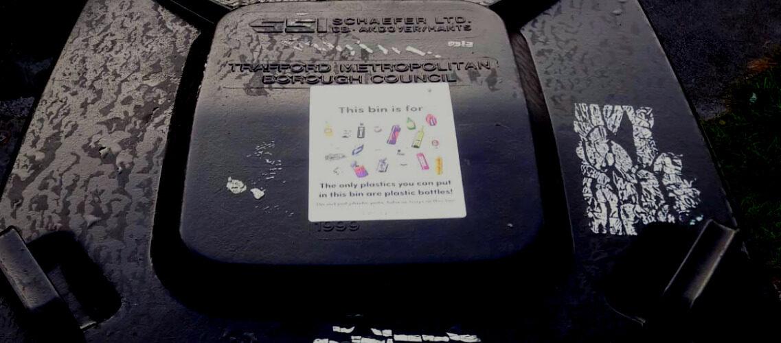 Bin sticker on black Trafford bin