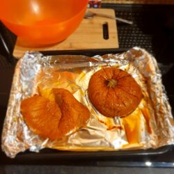 Baked pumpkin on a baking tray