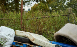 Fly tipped waste on a country road
