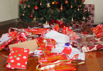 Unwrapped presents in front of Christmas tree