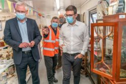 Mayor of Greater Manchester Andy Burnham being shown round the new Renew Shop in Oldham, Greater Manchester